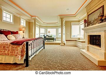 Beautiful bedroom with elegant bedding and a glass door.
