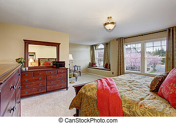 Beautiful bedroom with perfect golden bedding and carpet.