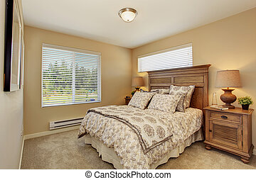 Beautiful bedroom with rich carved wood furniture -...