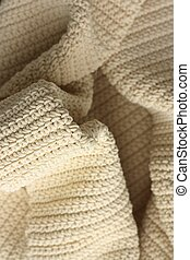 Beautiful beige knitted fabric close up view