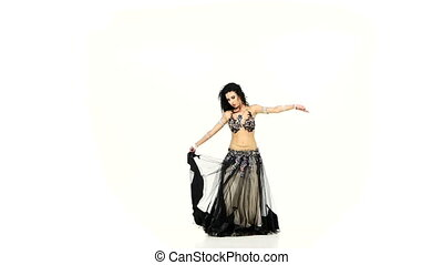 Beautiful belly dancer dark hair, shaking her hips and...