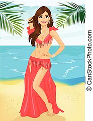 Beautiful belly dancer harem woman in a red stage costume on beach