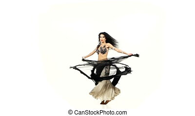 Beautiful belly dancer wave her dark hair, shaking her hips...