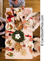 Beautiful big family celebrating Christmas together.