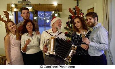 Beautiful big family celebrating Christmas together