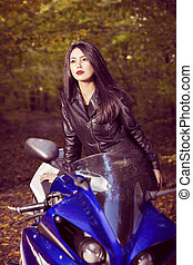 Beautiful Biker girl on a motorcycle
