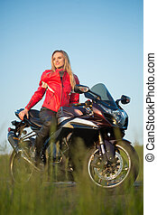 biker  woman sitting on a motorcycle.