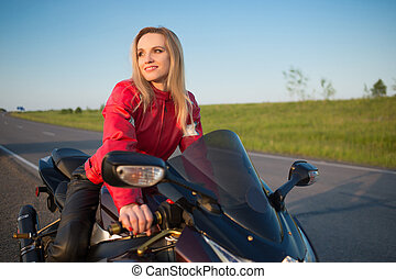 biker  woman sitting on a motorcycle.