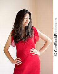 Beautiful biracial teen girl in elegant red dress
