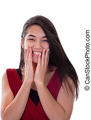 Beautiful biracial teen girl in red dress excited, hands on face