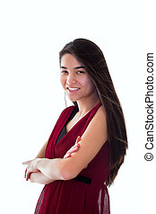 Beautiful biracial teen girl in red dress standing arms crossed,