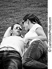 beautiful black and white of young punk lovers laying on the...