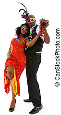 Beautiful Black Couple Dressed for Mardi Gras Party Dancing...