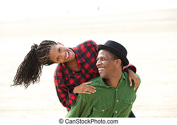 Beautiful black couple smiling outdoors