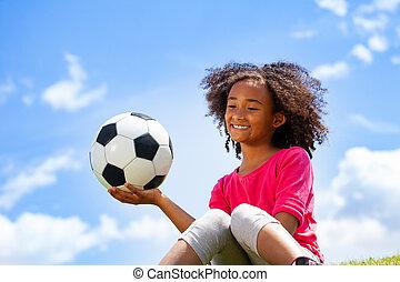 Beautiful black girl portrait with football ball