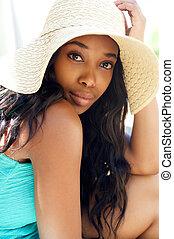 Beautiful black girl with sun hat