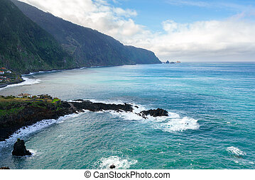 Beautiful black rock beach in Seixal, Madeira with waves crashing