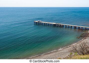 Black Sea shore with empty pear at spring season