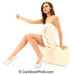 Beautiful Black Woman in Coctail Dress and Suitcase Hitchhiking
