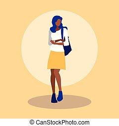 beautiful black woman modeling with handbag