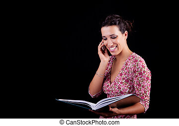 beautiful black woman on the reading information, isolated on black background