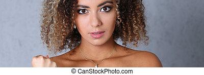 Beautiful black woman portrait. Fists his fist browsing...