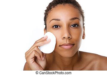 Beautiful black woman removing make up - Close up portrait...
