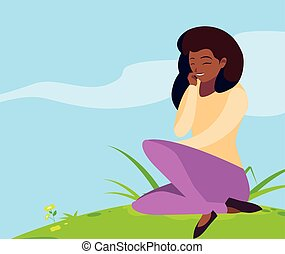 beautiful black woman seated in the park