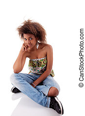 beautiful black  woman, sitting on the floor, isolated on white background