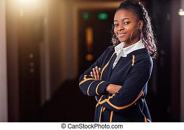 Beautiful black woman smiling at camera.