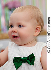 Beautiful blond baby smiling