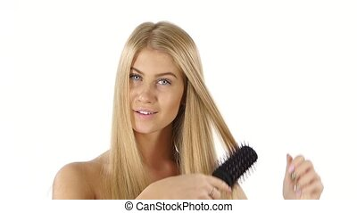 Beautiful Blond Brushing Her Hair. slow motion. Close up, bathroom