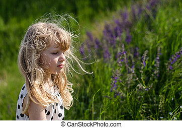beautiful blond child in meadow