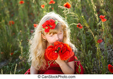beautiful blond child with flowers