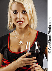 Beautiful blond drinking red wine