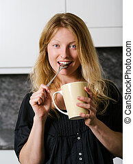 Beautiful blond enjoying coffee