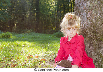 blond girl in autumn forrest