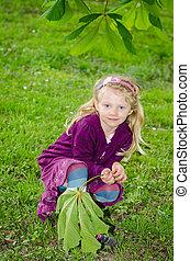 beautiful blond girl in green grass
