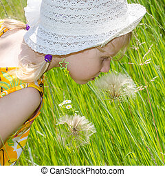 beautiful blond girl in hat and flower