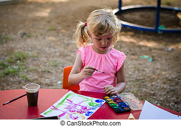 beautiful blond girl painting