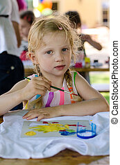 blond girl painting