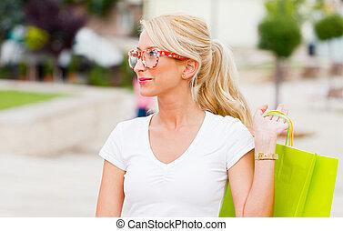 Beautiful Blond Girl Shopping in City