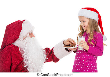 Beautiful blond girl treating Old Santa Claus with white beard with cookies and milk. Standing together isolated over white background