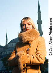 Beautiful blond girl wearing winter coat