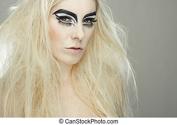 beautiful blond girl with cat eyes make-up