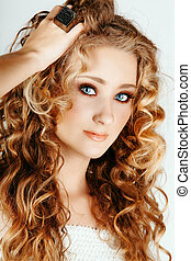 beautiful blond girl with curly hair