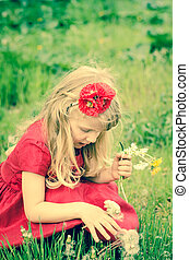 blond girl with dandelion