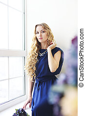 Beautiful blond girl with long curly hair