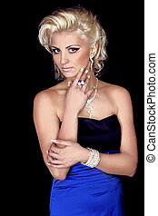 Beautiful Blond hairstyle Girl with evening make-up. Jewelry Fashion and beauty