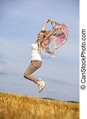 beautiful blond jumping teenager
